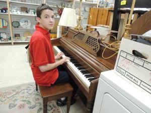 The Lifesavers Foundation Upscale Resale piano boy c