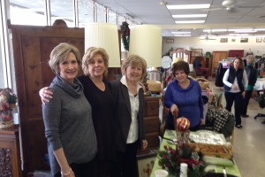 women at upscale resale store
