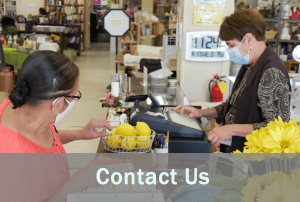 contact us with women at thrift store