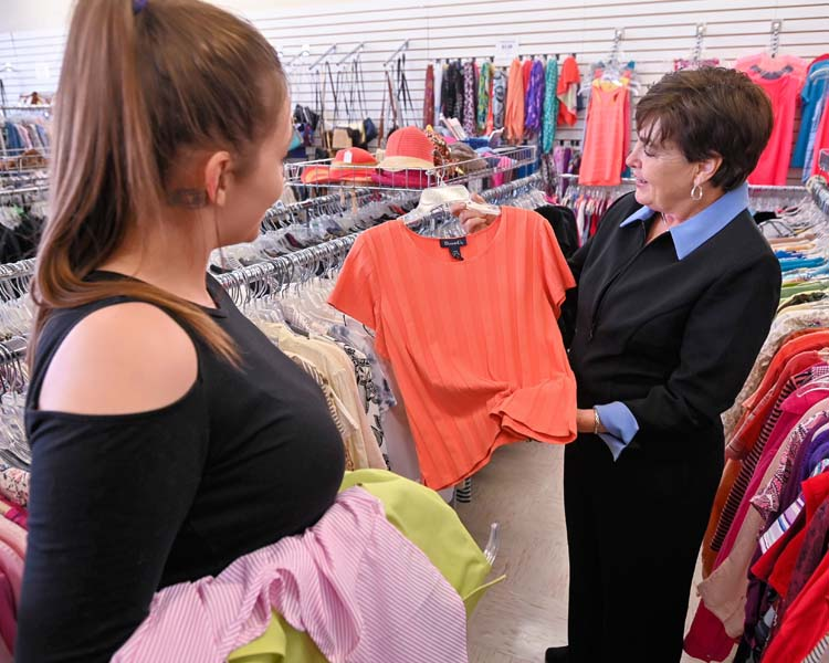 Upscale Resale manager with thrift store volunteer