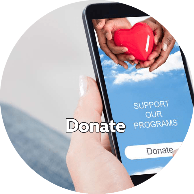 woman holding phone getting ready to donate to charity