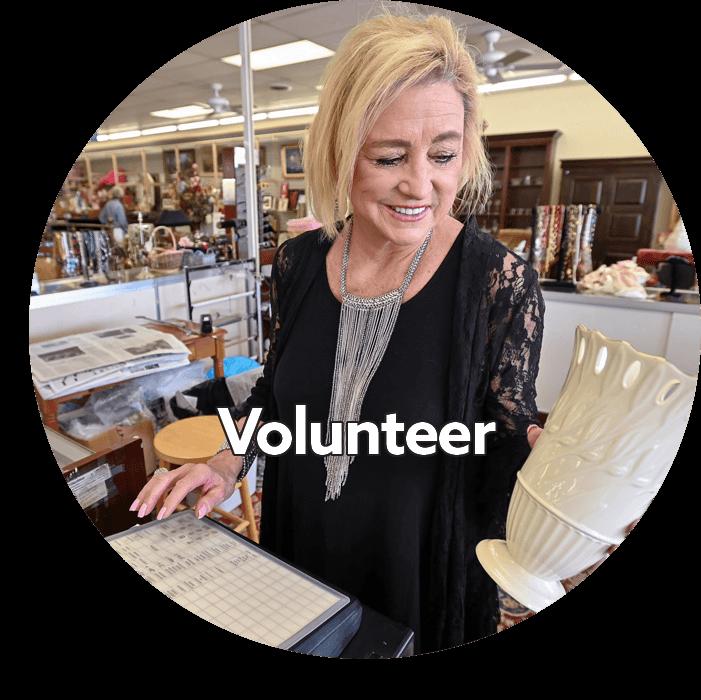 woman volunteering at upscale resale